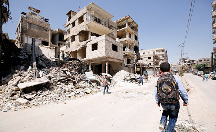 Разрушенные здания в городе Кафр-Батна