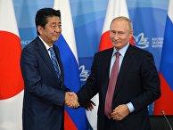 Владимир Путин и премьер-министр Японии Синдзо Абэ на пресс-конференции по итогам переговоров в рамках IV Восточного экономического форума на территории ДВФУ на острове Русский. 10 сентября 2018