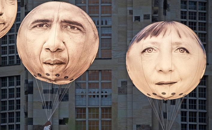 Шары с портретами Ангелы Меркель и Барака Обамы накануне встречи министров финансов G7 в Дрездене