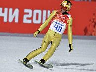 Нориаки Касай (Япония) в финале индивидуальных соревнований по прыжкам с большого трамплина (К-125) среди мужчин