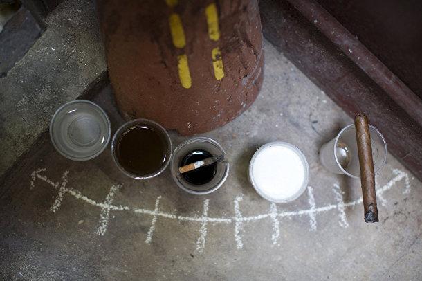 Подношения духам в доме, где проходит церемония сантерии