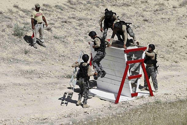 Иорданские полицейские на 6-х ежегодных соревнованиях военных подразделений под эгидой короля Иордании Абдаллы II
