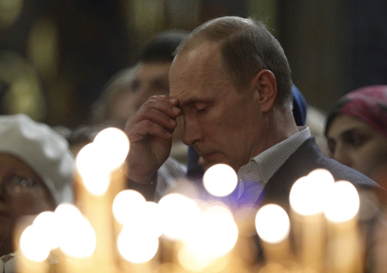 Владимир Путин на рождественской службе в Сочи
