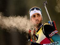Мартен Фуркад (Франция) во время пристрелки перед началом индивидуальной гонки среди мужчин на первом этапе Кубка мира по биатлону сезона 2018/19 в словенской Поклюке