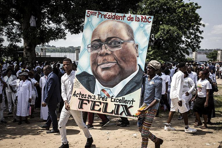 Сторонники избранного президента Демократической Республики Конго Феликса Чисекеди во время инаугурации в Киншасе