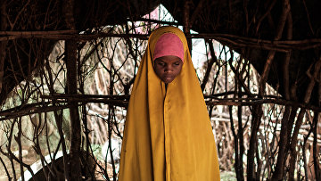 Девочка, беженец из Сомали в лагере для беженцев в Кении