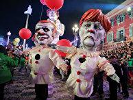 Фигуры, изображающие Макрона и Меркель, на карнавале в Ницце