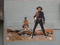 Граффити вПариже, изображающее героев фильма «Однажды наДиком Западе» Серджо Леоне