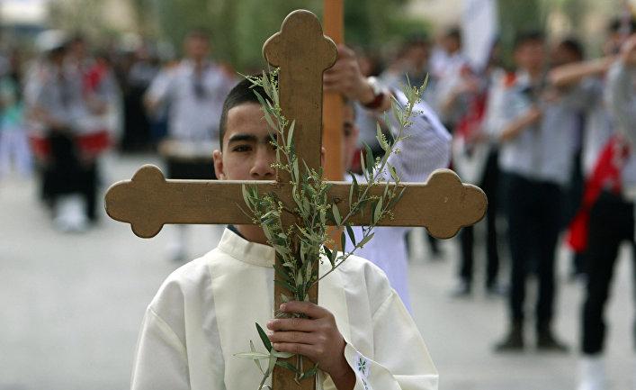 Палестинские христиане на церемонии, посвященной Пальмовому воскресенью