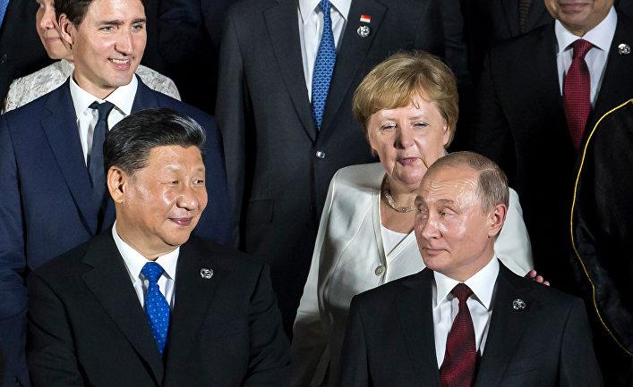 Канцлер Германии Ангела Меркель, президент России Владимир Путин, председатель КНР Си Цзиньпин во время саммита G20 в Осаке