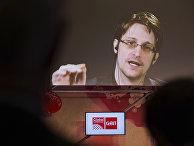 Эдвард Сноуден выступает по видеосвязи на IT-выставке CeBIT в Германии