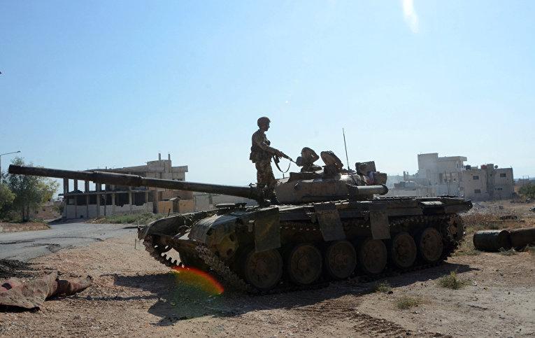 Сирийские военные в городе Хан-Шейхун