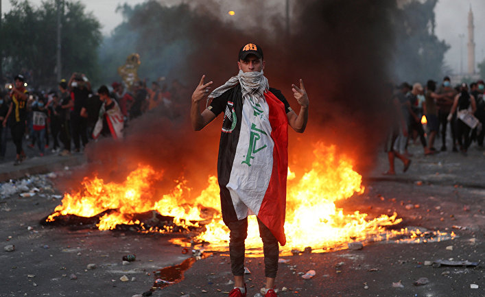 Участник антиправительственных протестов в Багдаде, Ирак