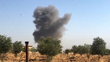 Дым от бомбардировок территории Сирии турецкими войсками 10 октября 2019 года
