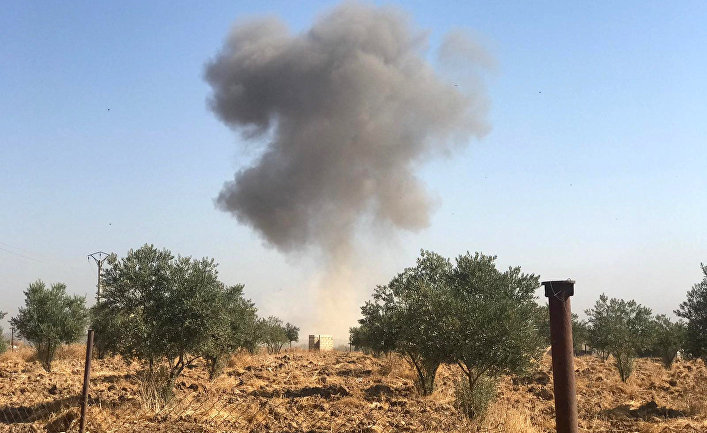 Дым над деревней Тель-аркам, Сирия