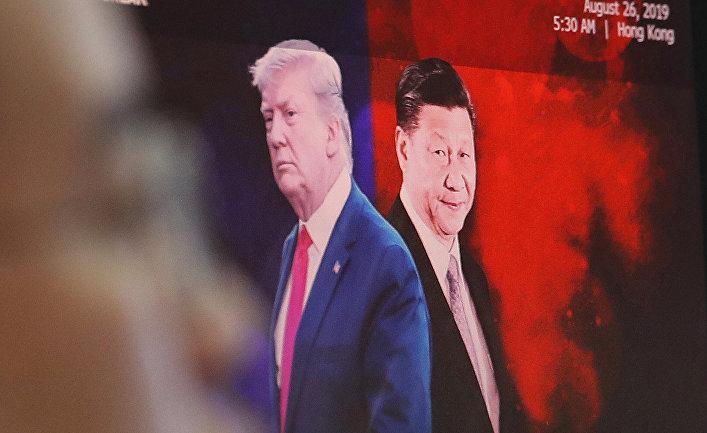Президент США Дональд Трамп пожимает руку председателю Китая Си Цзиньпину во время саммита лидеров G20 в Осаке