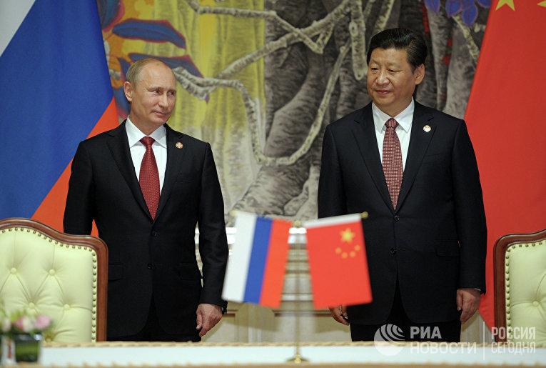 Президент России Владимир Путин и председатель Китайской народной республики Си Цзиньпин