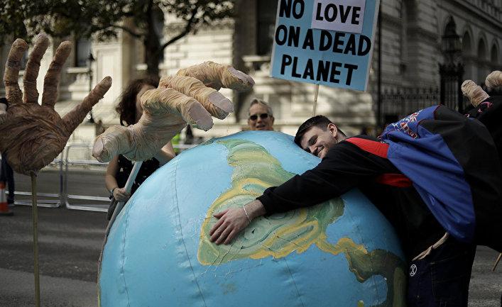 Протестующий против изменения климата в Лондоне