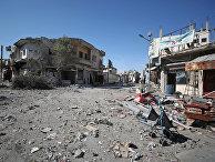 Поврежденные дома в городе Саракиб в провинции Идлиб, Сирия