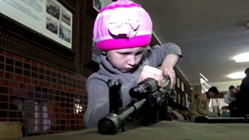 Watch these Russian children assemble and dismantle Kalashnikov rifles in seconds