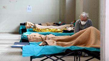 Пациенты в больнице в Брешии, Италия