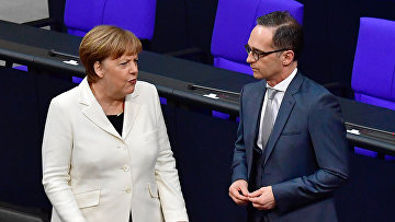 Канцлер Германии Ангела Меркель и министр иностранных дел Германии Хайко Маас
