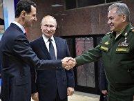 Президент РФ Владимир Путин, президент Сирии Башар Асад и министр обороны РФ Сергей Шойгу во время встречи в командном пункте группировки Вооруженных Сил России в Сирии