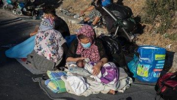 Последствия пожара в лагере мигрантов в Греции