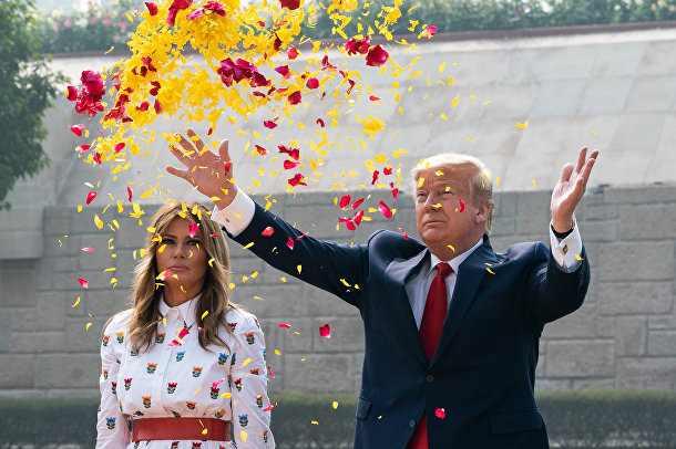 President Donald J. Trump and First Lady Melania Trump scatter flower petals in honor of Mahatma Gandhi during a wreath laying ceremony at the Raj Ghat Tuesday, Feb. 25, 2020, in New Delhi, India.