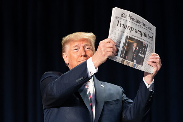 President Donald J. Trump holds up a copy of The Washington Post during the 2020 National Prayer Breakfast Thursday, Feb. 6, 2020, at the Washington Hilton in Washington, D.C.