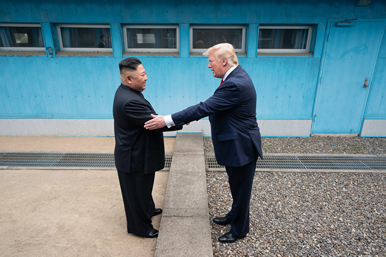 President Donald J. Trump shakes hands with Chairman of the Workers' Party of Korea Kim Jong Un Sunday, June 30, 2019, as the two leaders meet at the Korean Demilitarized Zone.
