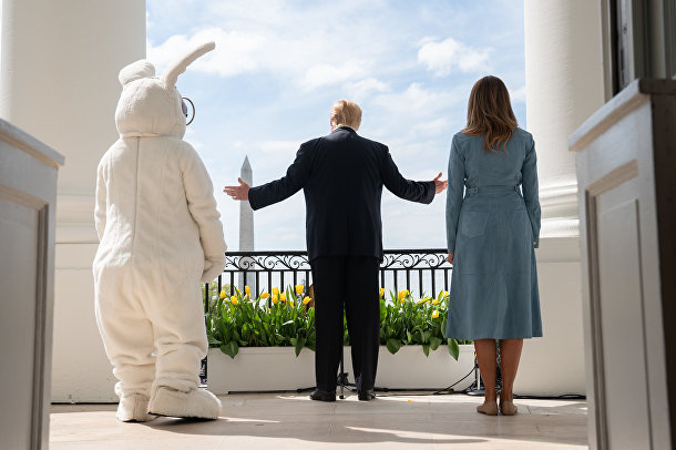 President Donald J. Trump and First Lady Melania Trump stand on the South Portico balcony of the White House as they welcome guests Monday, April 22, 2019, to the 141st White House Easter Egg Roll.