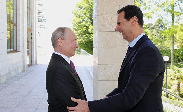 Президент РФ Владимир Путин и президент Сирийской арабской республики Башар Асад  во время встречи. 17 мая 2018