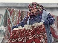 Продавец ковров в Туркменистане