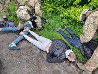 Подозреваемые, задержанные полицией в городе Бровары под Киевом, Украина