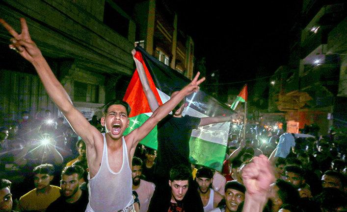 Палестинцы празднуют прекращение огня в секторе Газа