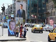 Плакаты с изображением президента Сирии Башара Асада в Дамаске, Сирия.