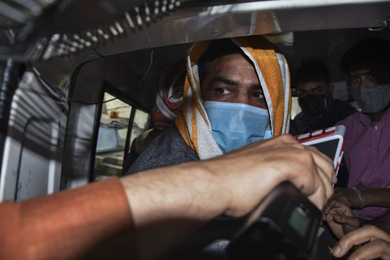 Индийский борец Сушил Кумар после ареста полицией в Нью-Дели, Индия