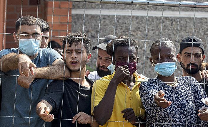 Мигранты в лагере беженцев в деревне Веребяй, Литва